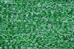 羊毛围巾或毛线衣纹理关闭 绿色被编织的球衣bac 免版税库存照片