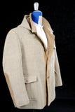 羊毛外套灰棕色 库存图片