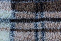 羊毛纹理是与格子花呢披肩条纹的灰色褐色  免版税库存照片