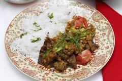 羊羔和分裂豌豆咖喱膳食 库存图片