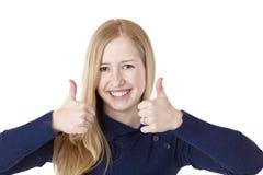 美丽两个显示微笑的赞许妇女年轻人 库存照片