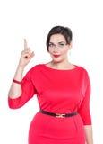 美丽加上显示在某事的大小妇女由手指 免版税库存图片
