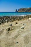 美丽如画的石海滩 库存照片
