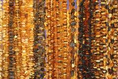 美丽琥珀色的小珠 免版税库存照片