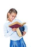 美丽的书玻璃女小学生 免版税库存图片
