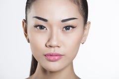 美丽的亚洲女孩面孔特写镜头 免版税库存照片