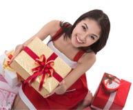 美丽的亚洲女服圣诞老人服装 免版税图库摄影