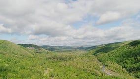 美丽的低山和小山和森林前景的 影视素材