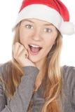 美丽的克劳斯女孩帽子圣诞老人 免版税库存图片