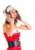 美丽的克劳斯给女孩圣诞老人年轻人&# 免版税图库摄影
