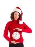 美丽的克劳斯给女孩怀孕的圣诞老人&# 免版税库存图片