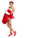 美丽的克劳斯给女孩圣诞老人性感佩&# 免版税库存照片