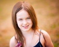 美丽的六年女孩老的纵向 免版税库存照片