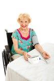 美丽的前辈采取拥有血压 免版税图库摄影