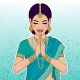 说美丽的印地安的妇女namaste 免版税库存图片