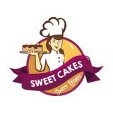 美丽的厨师举甜蛋糕商标 库存照片