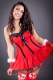 美丽的可爱的圣诞老人妇女 免版税库存图片