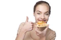 美丽的吃妇女年轻人 库存图片