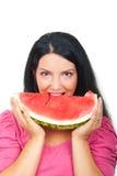 美丽的吃的西瓜妇女 免版税库存图片