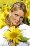 美丽的向日葵妇女 免版税图库摄影