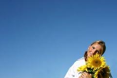 美丽的向日葵妇女 库存照片