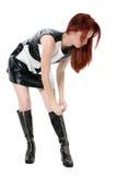 美丽的启动压缩她的红头发人  免版税图库摄影