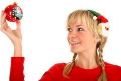 美丽的圣诞节女孩递她的藏品玩具 库存照片