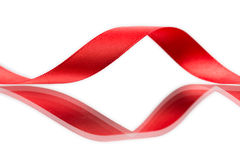 美丽的在白色的织品红色丝带 库存照片