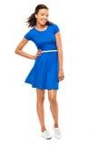美丽的在白色bac隔绝的混合的族种妇女性感的蓝色礼服 免版税图库摄影