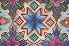 美丽的地毯的表面的照片手工制造 库存图片