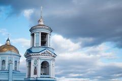 美丽的基督教会在蓝色多云天空的背景中 免版税库存照片