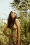 美丽的夏天星期日妇女 免版税库存照片