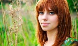 美丽的头发纵向红色妇女 库存照片