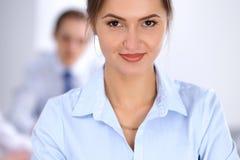 美丽的女商人在会议上 免版税库存照片