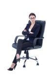 年轻美丽的女商人坐被隔绝的椅子  免版税库存照片