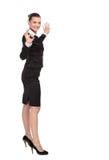 美丽的女商人显示充满幸福的好标志 免版税图库摄影