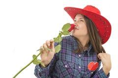 美丽的女孩与起来了,心脏和红色帽子 库存照片