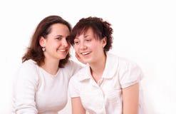 美丽的女孩二个年轻人 免版税库存图片