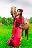 美丽的女孩吉普赛人马 图库摄影