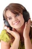 美丽的女孩听的音乐少年 库存照片