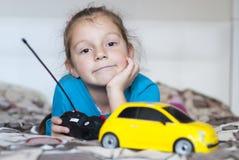 美丽的女孩和玩具汽车 免版税图库摄影