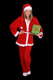 美丽的女孩在与礼品的圣诞老人服装 图库摄影