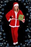 美丽的女孩在与礼品的圣诞老人服装 库存照片