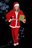 美丽的女孩在与礼品的圣诞老人服装 免版税库存照片