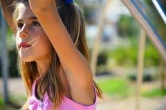 美丽的女孩在操场 免版税库存图片