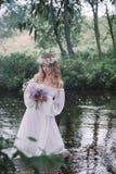 美丽的女孩在河 库存照片