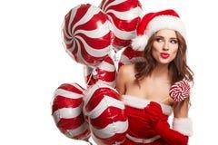 年轻美丽的女孩在演播室新年,圣诞节 免版税库存图片