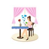 美丽的女孩坐在桌,饮用的茶上,并且反应m 库存图片