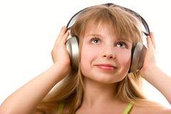 美丽的女孩愉快的耳机 免版税图库摄影