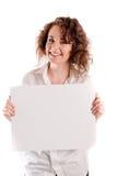 年轻美丽的女孩拿着您的一个空的白色标志能填写 图库摄影